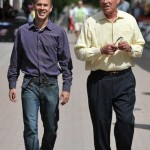 Bob and Gregg Vanourek enjoying a pleasant stroll down the street.