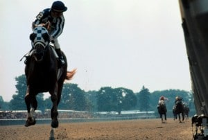 Leadership writers and speakers Bob and Gregg Vanourek use a picture of Secretariat to show the accomplishment and difficulty of becoming a triple crown leader.