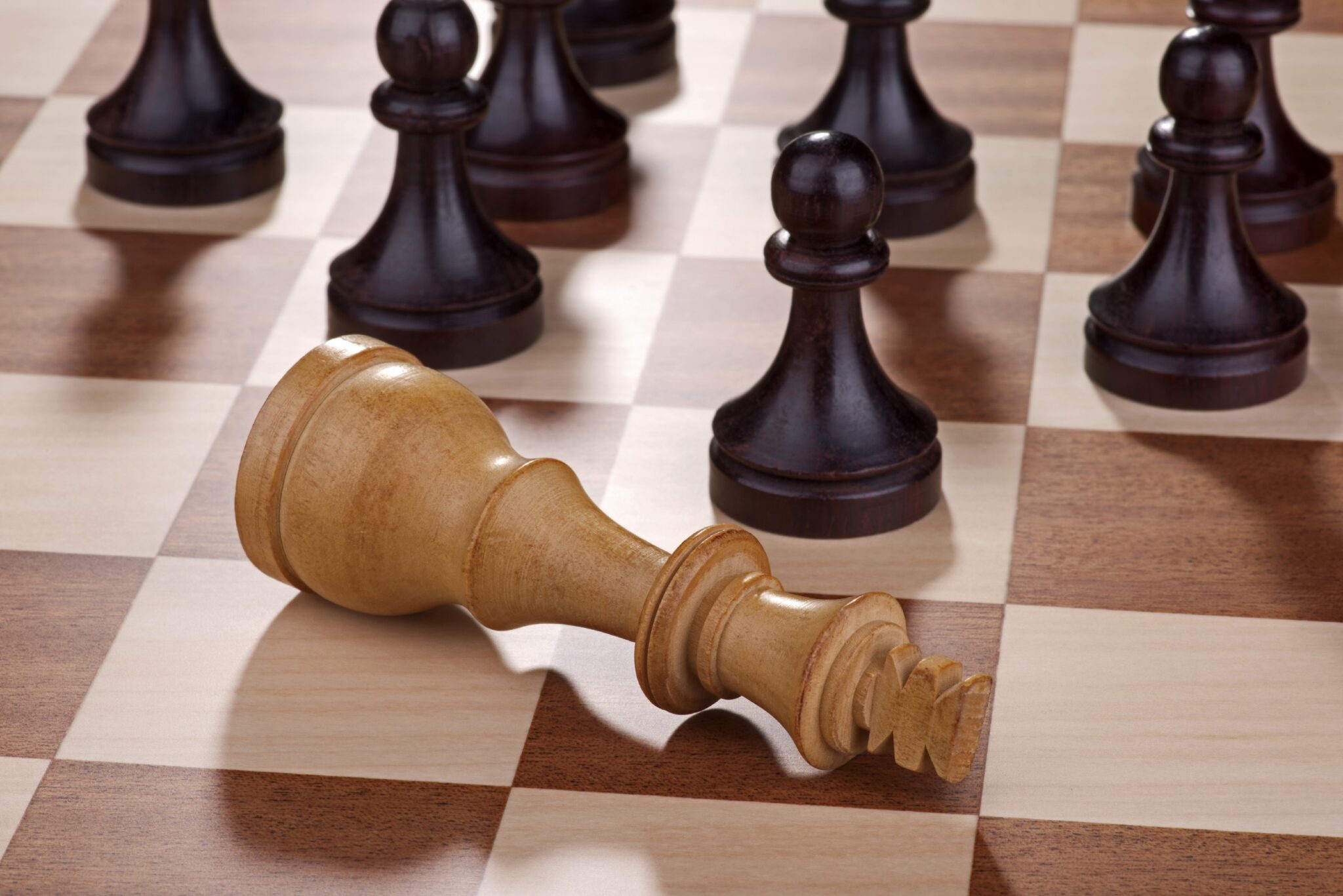 Leadership speakers and authors, Bob Vanourek and Gregg Vanourek, use a picture of a chess king laying on it's side to illustrate the falling of a great leader.