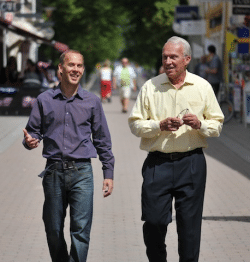 Bob and Gregg Vanourek walking down the street 2