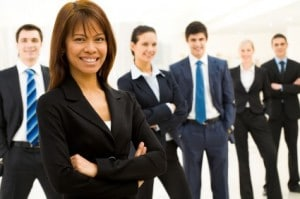 Leadership speakers and authors Bob Vanourek and Gregg Vanourek use this image of a smiling woman in front of other people to illustrate the importance of valuing your employees.