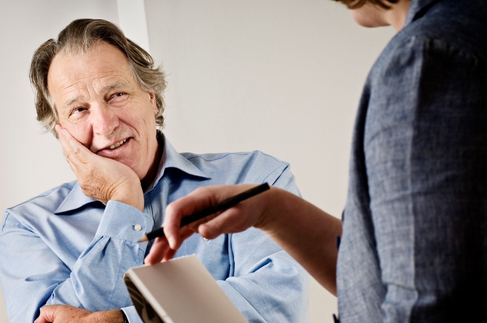 Leadership speakers and authors, Bob Vanourek and Gregg Vanourek, use the image of an older gentleman listening intently to a co-worker to illustrate the feedback process